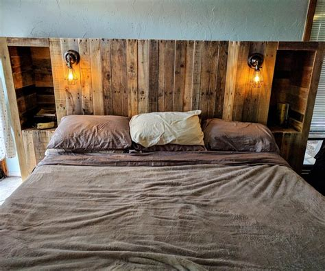 diy headboard pallet diy pallet wood headboard with a secret stolen from you wore it better ilove2make