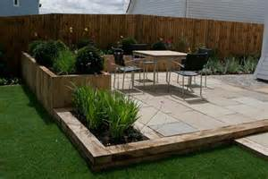 new oak sleepers and sandstone paving combine to provide a