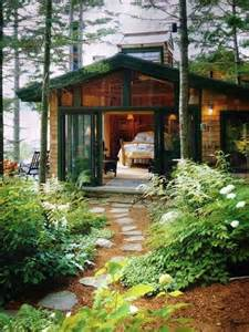 beautiful tiny house in the woods with green trim love