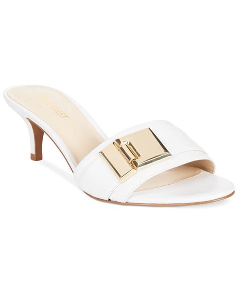 white dress sandals lyst nine west yulenia low heel dress sandals in white