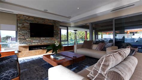 contemporary living room with stacked stone accent wall modern house design interior exterior pictures