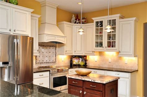 yellow kitchen appliances white cabinets dark granite stainless steel appliances