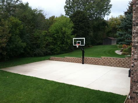 best backyard basketball hoop in the middle there s pro dunk platinum basketball system on the concrete slab sport court