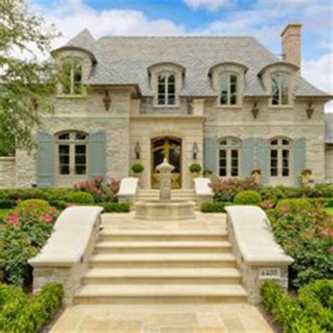 french chateau style home in stucco cast stone french chateau style home in stucco cast stone