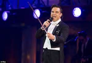 reveal robbie williams books robbie williams reveals he won t return to take that