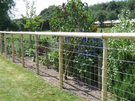 wood wire fence on wire fence fence and fencing sawdon fence farm fence company serving mid michigan