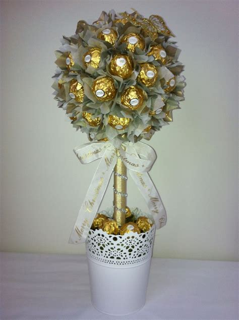 how to make a rocher christmas tree with 48 rocher chocolates large ferrero rocher lolly tree with ribbon creative edibles
