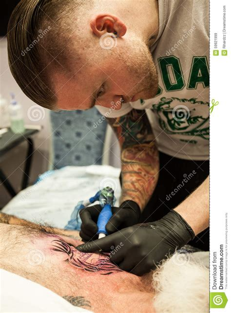 tattoos at work artists at work editorial stock image image 59921999