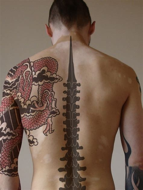 awesome back tattoos for men 75 best spine tattoos for and designs