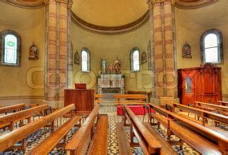 Parts Of Church Interior by Pews And Altar With Jesus And Joseph Sculptures As