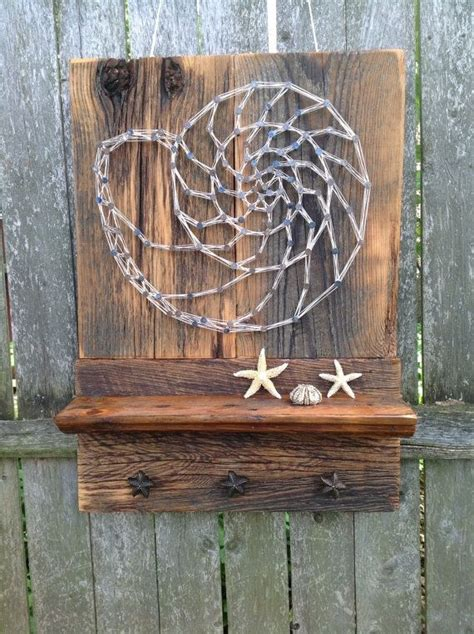 crafted reclaimed wood shelf with featured nautilus