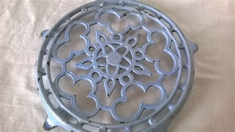 cast iron trivet decorative plate stand blue enamelware
