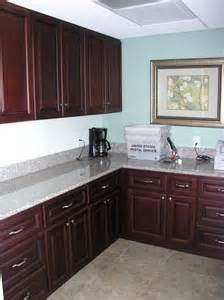granite countertops and cherry cabinets s kitchen
