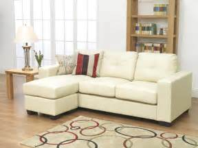 small faux white ivory leather l shaped couch combined lacquered oak wood end table of splendid