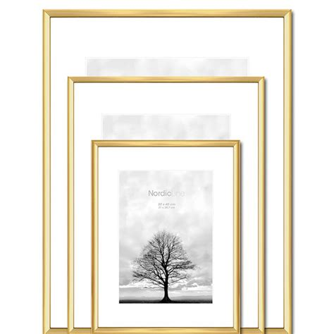 framing pictures brass think minimalistic picture frame