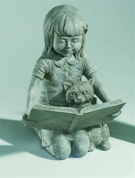 sarah girl reading book  kitten sculpture