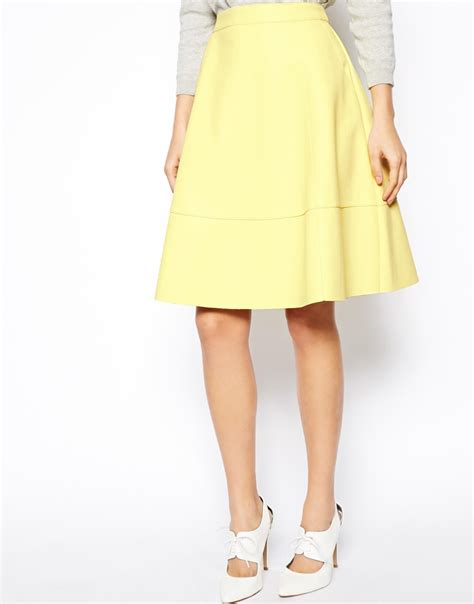 asos midi skirt in leather look in yellow paleyellow