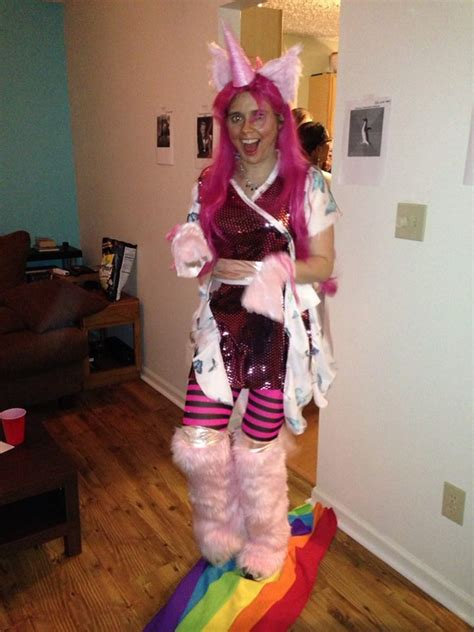 pink fluffy unicorns dancing  rainbows