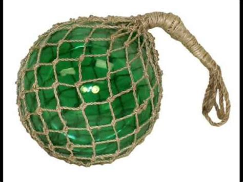 glass fishing float with rope wrapped in hemp rope glass