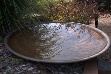 this copper bird bath is spun by a local metal spinner it