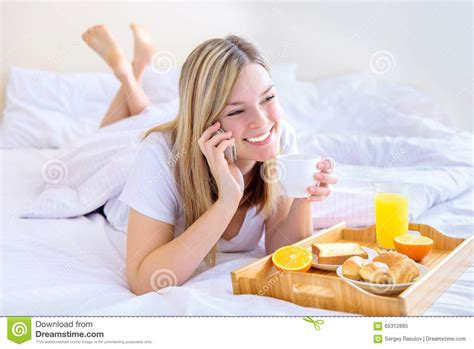 eating in bed women eating breakfast in bed stock image image 65312885