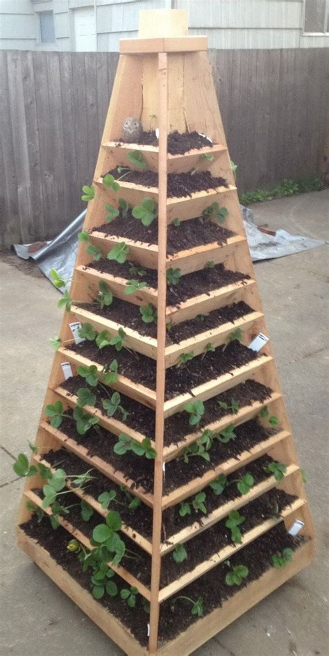How To Build Your Own Vertical Garden How To Build A Vertical Garden Pyramid Tower For Your Next