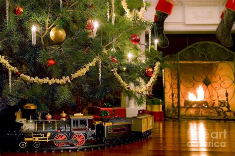 christmas trains for under the tree the tree photograph by diane diederich