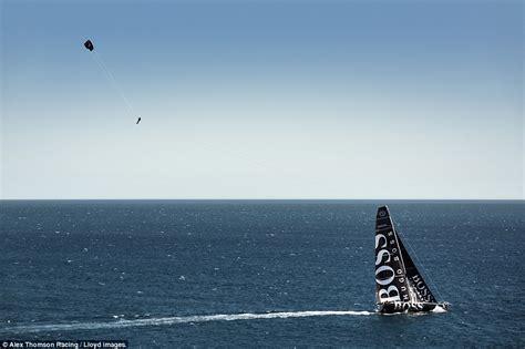 propel a boat alex thomson s skywalk stunt sees yachtsman kitesurf in