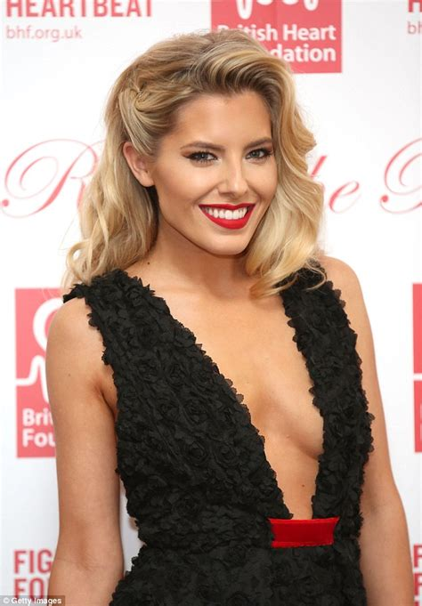mollie king sizzles in very low cut black dress at charity