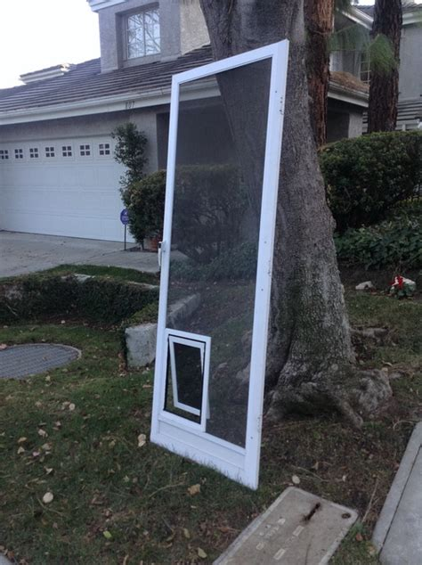 Patio Screen Door With Pet Entrance 25 Factors To Consider Before Installing Door For Screen Door Interior Exterior Ideas