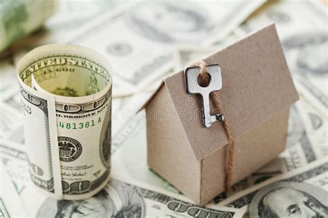 cost of buying a house with cash model cardboard home key and dollar money house building insurance housewarming loan real