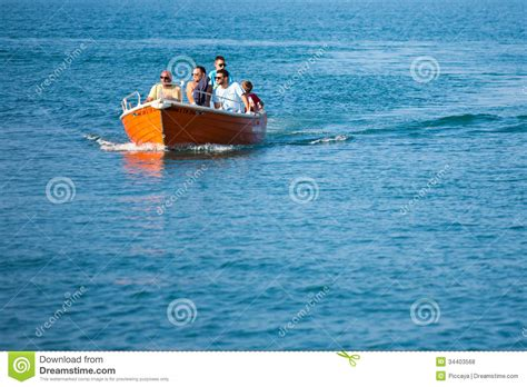 boating license greece people having fun with their motor boat editorial stock