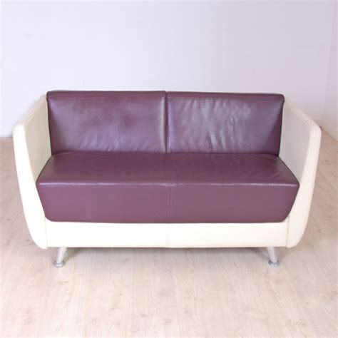 reception two seater sofa and maroon sofa