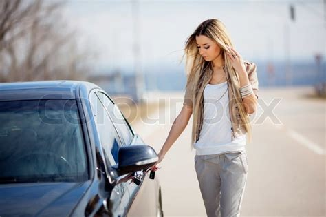 Girl with car   Stock Photo   Colourbox