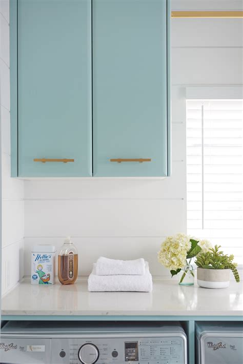 blue cabinets giggles and laundry turquoise laundry room cabinet paint color home bunch