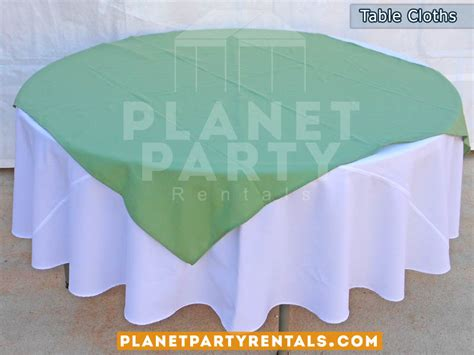 white table cloth on table with turquoise