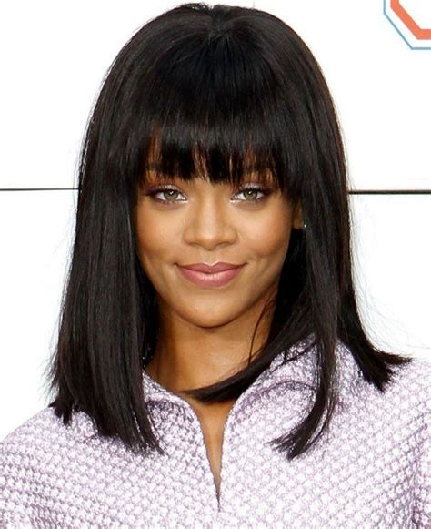 haircut with irregular length irregular bangs long hairstyle with waves bangs and