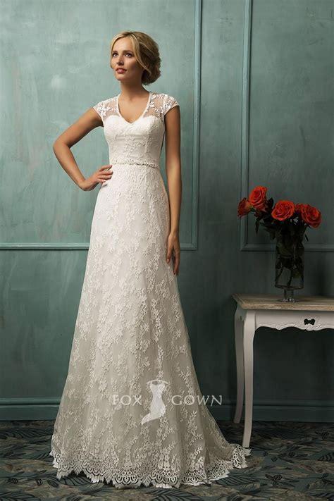 illusion cap sleeve  neckline lace   bridal gown