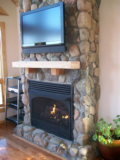 River Rock Veneer Fireplace by Fireplaces