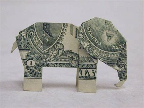 Dollar Bill Origami Elephant - file origami made from an american 1 dollar bill of an