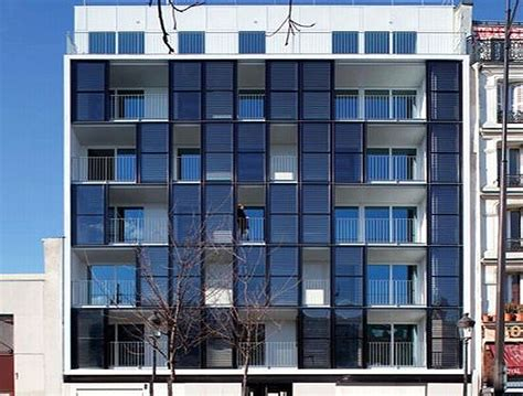 Movable Walls For Apartments checkerboard solar clad public housing project pops up in