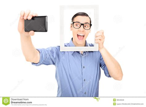 swing lifestyle mobile man taking a selfie and holding a picture frame stock