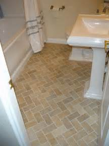 3 215 6 inch porcelain tile installed with a herringbone