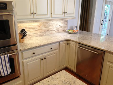backsplash with white kitchen cabinets travertine backsplash with bone white cabinets crema romana granite ge cafe cdwt980vss