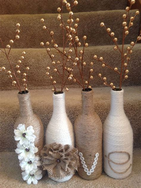 bottel oorgetrek met net pinterest wine bottle set twine and yarn wrapped wine bottles for a great rustic set wine bottle