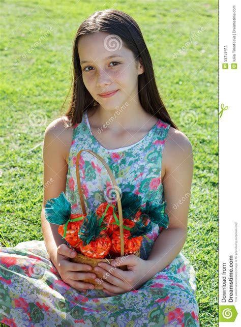 sweetest preteens smiling cute teen girl holding basket with carrot of sweet