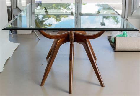 an italian modern mahogany and glass dining table italy