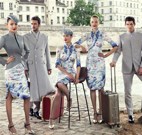 hainan airlines unveils new uniforms at couture week skytrax