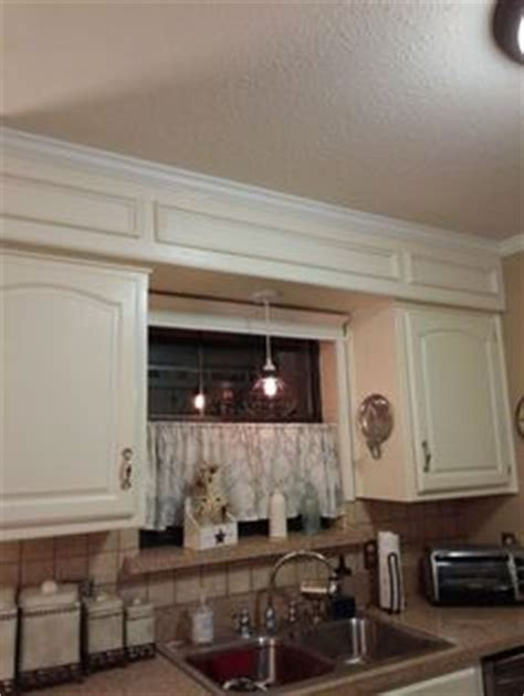 hide soffit above kitchen cabinets by adding crown molding hide soffit above kitchen cabinets by adding crown molding