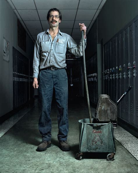 a custodian is much like a janitor who among others things clean stuff so he carries a mop